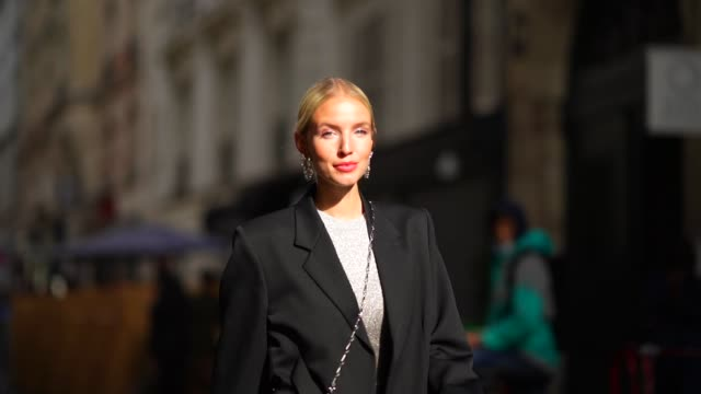 leonie hanne wears a black oversized blazer jacket, a grey glitter dress, a silver shiny sequined bag with attached floral designs, black leather... - glittering stock videos & royalty-free footage
