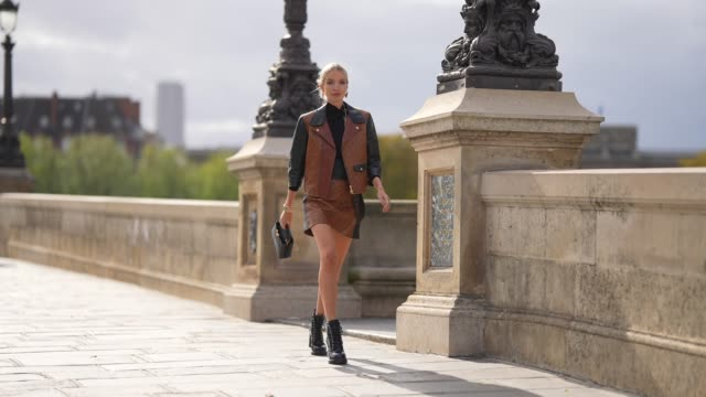 leonie hanne wears a black turtleneck pullover black and brown leather monogram vuitton jacket a brown leather short vuitton skirt with printed... - turtleneck stock videos & royalty-free footage