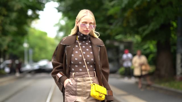 leonie hanne wears a brown fendi mesh top with printed logos beige pants a yellow fendi bag yellow shoes outside the fendi show during milan fashion... - spring summer collection stock videos & royalty-free footage