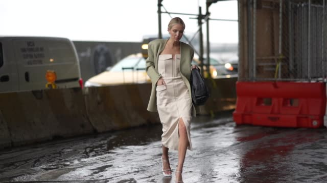 leonie hanne wears a green jacket with shoulder pads a black large puff bag an offshoulder dress white shoes during new york fashion week fall winter... - shoulder bag stock videos & royalty-free footage