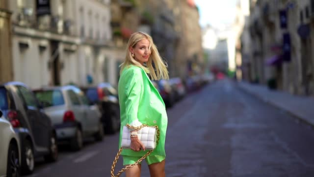stockvideo's en b-roll-footage met leonie hanne wears a pale green oversized long blazer jacket from bernadette, pale green short pants from bernadette, a white cropped top from skin,... - blazer