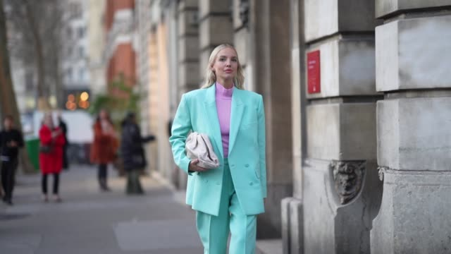 stockvideo's en b-roll-footage met leonie hanne wears a pink turtleneck pullover a blue/turquoise oversized blazer jacket a puff bag suit pants during paris fashion week haute couture... - coltrui