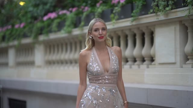 leonie hanne wears earrings a low neck lace dress with sequined inserts heels shoes outside amfar dinner during paris fashion week haute couture... - eleganter schuh stock-videos und b-roll-filmmaterial