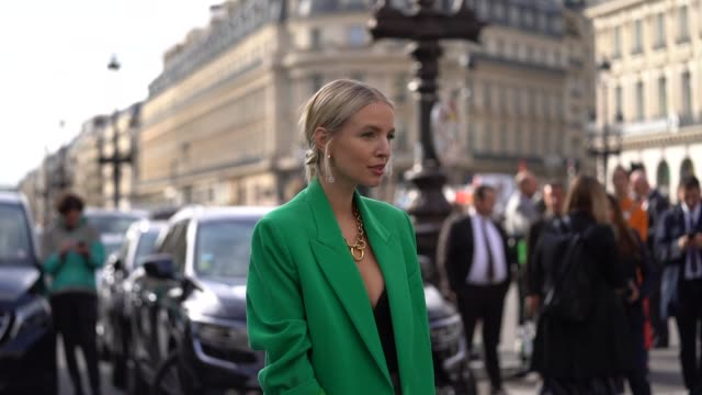 leonie hanne wears earrings bracelets a green blazer jacket a golden ring necklace a bustier black top grey prince of wales check pattern fulllength... - grey jacket stock videos and b-roll footage