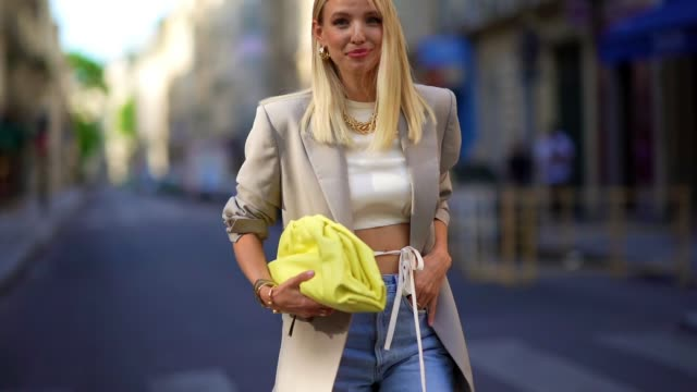 leonie hanne wears golden earrings, a golden necklace, a white cropped top from orseund iris, a gray oversized long blazer jacket from frankie shop,... - mesh textile stock videos & royalty-free footage