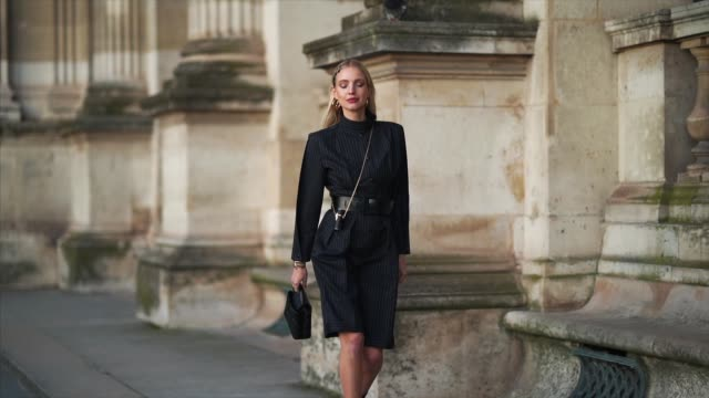 leonie hanne wears hair pins, a black long striped dress with shoulder pads, a black leather belt, a vuitton cylinder shaped mini bag, a vuitton bag,... - pattern stock videos & royalty-free footage