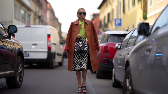 leonie hanne wears sunglasses a brown leather coat a yellow quilted jacket a black and white zebra print skirt a tod's bag balenciaga shoes outside... - zebra print stock videos & royalty-free footage