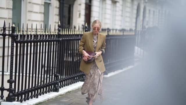 leonie hanne wears sunglasses, a green khaki oversized blazer jacket, a loewe bag, a brown flowing dress with printed polka dots, sandals, during... - spotted stock videos & royalty-free footage