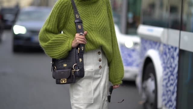 leonie hanne wears sunglasses a green wool turtleneck knitted pullover a givenchy bag white side slit skirt white boots outside beautiful people... - turtleneck stock videos & royalty-free footage