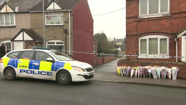 man and woman questioned by police england yorkshire rotherham dinnington ext gvs of scene where body of leonne weeks was found flower laid on... - 仮設追悼施設点の映像素材/bロール