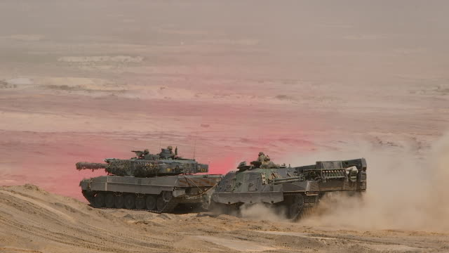 A Leopard 2 main battle tank of the Bundeswehr the German armed forces takes part in the NATO Noble Jump military exercises during a live fire...