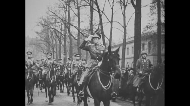 vs leopold iii successor to his father the late albert i of belgium rides on horseback at head of military parade he salutes / note exact day not... - nachfolger stock-videos und b-roll-filmmaterial