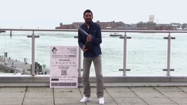 stockvideo's en b-roll-footage met leroy bagley from southsea who won £3 000 on the lotto jackpot on saturday celebrates at the emirates spinnaker tower in portsmouth. - loterij kansspel