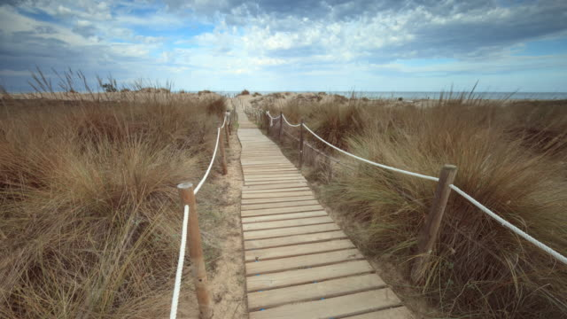les deveses beach time lapse in denia - pedestrian walkway stock videos & royalty-free footage