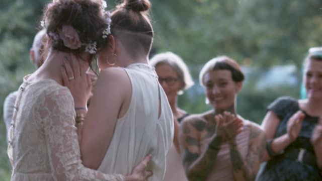 lesbian couple celebrating their wedding with their freinds - wedding stock videos & royalty-free footage