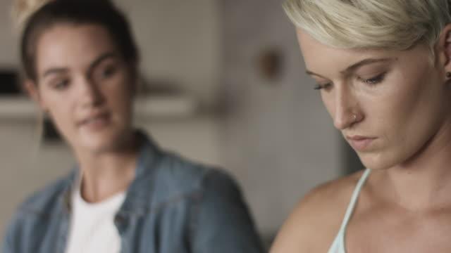vídeos de stock e filmes b-roll de lesbian couple drink white wine, close up - cabelo curto comprimento de cabelo