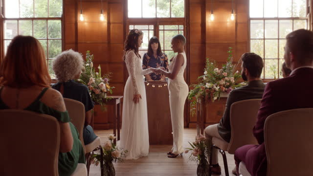 lesbian couple exchanging rings at wedding ceremony - full length stock videos & royalty-free footage