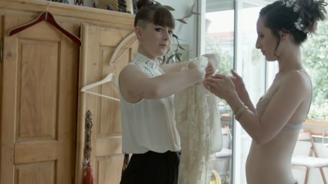 lesbian couple getting ready for their wedding - bra stock videos & royalty-free footage