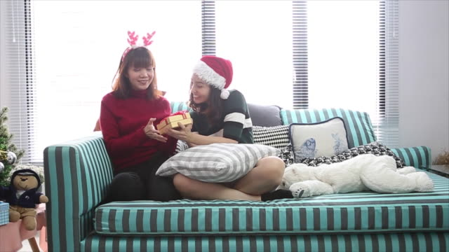 lesbian couple give gift and open christmas box - scissors stock videos and b-roll footage