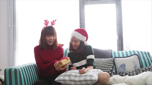 lesbian couple give gift in christmas event