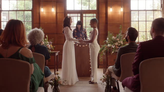 lesbian couple holding hands saying vows at wedding ceremony - full length stock videos & royalty-free footage