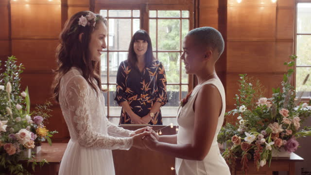 lesbian couple holding hands saying vows at wedding ceremony - 20 24 years stock videos & royalty-free footage