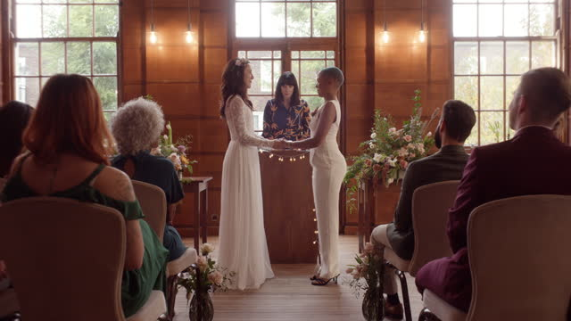 lesbian couple holding hands saying vows - full length stock videos & royalty-free footage