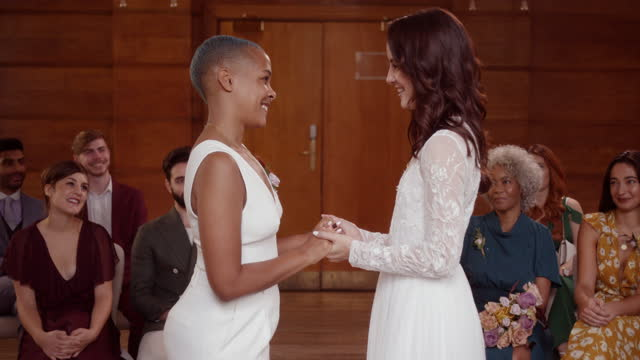 lesbian couple holding hands saying vows - 20 29 years stock videos & royalty-free footage