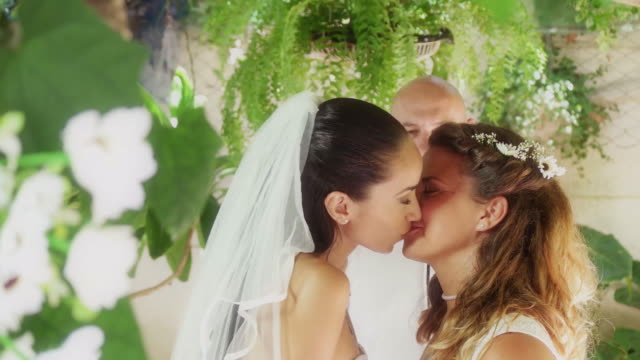 lesbian couple just married first kiss. - bouquet video stock e b–roll