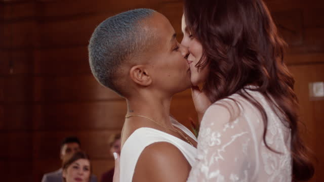 lesbian couple kissing at wedding ceremony - 20 29 years stock videos & royalty-free footage
