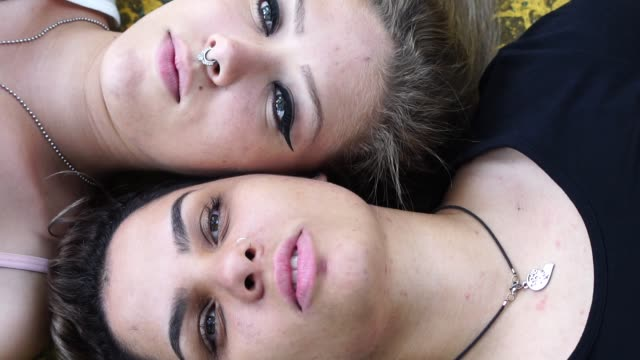 lesbian couple lying down at grass - women's issues stock videos & royalty-free footage
