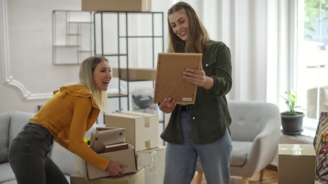 lesbian couple moving in new home - young couple stock videos & royalty-free footage