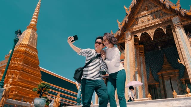 lesbian couple selfies at local landmark in thailand - local landmark stock videos & royalty-free footage