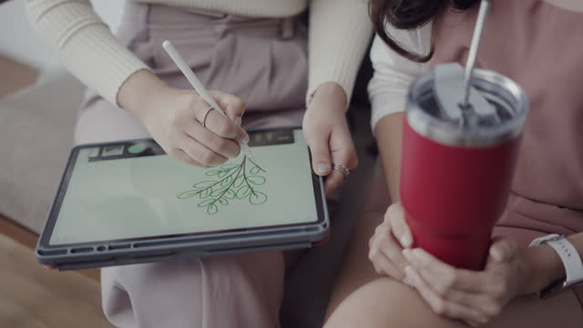 lesbian couple using tablet with stainless bottle - reusable stock videos & royalty-free footage