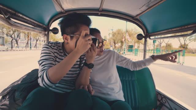 lesbian couple vlogging in tuk tuk - auto rickshaw stock videos & royalty-free footage