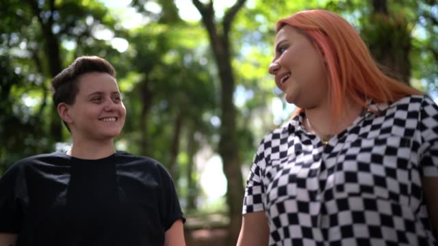 lesbian couple walking at city - multiculturalism stock videos & royalty-free footage