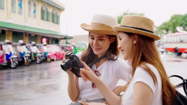 lesbian couple walking tour and photography as tourist attractions in thailand. - digital camera stock videos & royalty-free footage