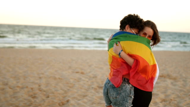 lesbian couple with rainbow flag - flag stock videos & royalty-free footage