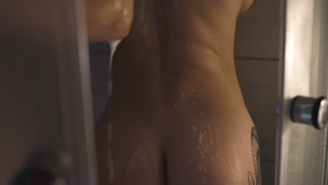 lesbian lgbt woman washes back of her girlfriend in shower - bagnato video stock e b–roll