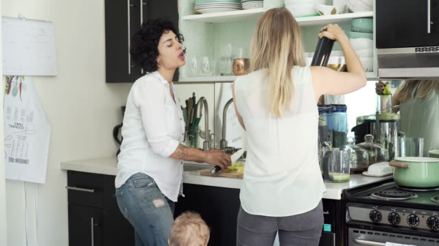 lesbian mothers and son standing in kitchen - food processor stock videos and b-roll footage