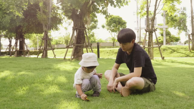 Lesbian playing with son in park