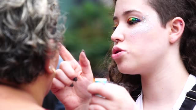lesbian young woman painting face - activist stock videos & royalty-free footage