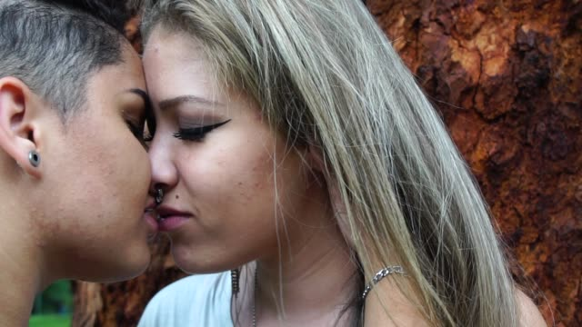 lesbians kissing in the park - temptation stock videos & royalty-free footage