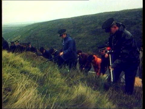 DNA evidence LIB NO RESALE North Yorkshire Police searching moors Police searching PAN to black plastic covering site VIEWs Police vehicles on moors...