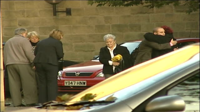 stockvideo's en b-roll-footage met man on trial 32 years after killing 7112006 yorkshire april garrett holding flowers and greeting other family members in courthouse carpark - lesley garrett