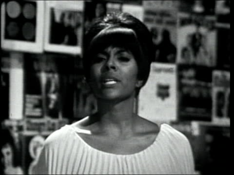 "vídeos de stock e filmes b-roll de leslie uggams briefly sings excerpt of ""sing along,"" then introduces the shangri-las. - television show"
