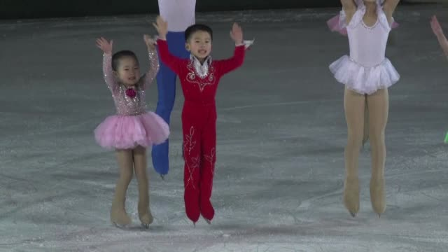 vídeos de stock e filmes b-roll de less than two days after the assassination of the half brother of north korea's leader small girls in frilly pastel leotards opened an ice skating... - body de ginástica