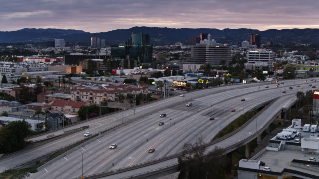 lessened traffic on la freeways during covid-19 pandemic - aerial - overpass road stock videos & royalty-free footage