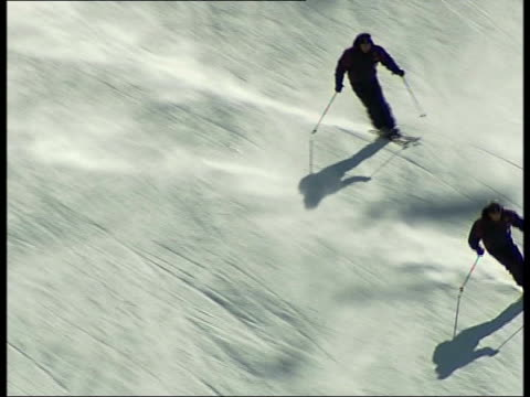 lessons to be learnt by london 2012 olympic team italy turin ext ***good top shot of skiers skiing down mountainside general view of alps person... - winter olympic games stock videos and b-roll footage