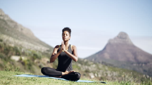 let the calm surround you - prayer pose yoga stock videos & royalty-free footage